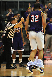 Northwestern State's DeQuann Hicks backpedals with his shorts down after a Demons' two points during the first half of a Southland Conference basketball tournament semifinal game against SFA, Friday, March 14, 2014, at Merrell Center in Katy, TX.