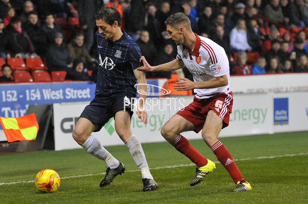 Southend United forward David Mooney and Sheffield United midfielder Chris Basham during the Sky Bet League 1 match between Sheffield Utd and Southend United at Bramall Lane, Sheffield, England on 14 November 2015. Photo by Ian Lyall.