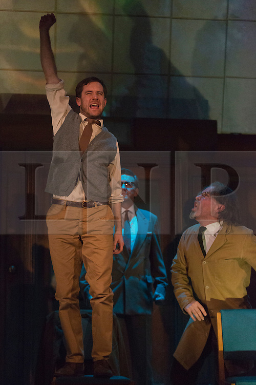"© Licensed to London News Pictures. 08/05/2014. London, England. Pictured: Sam Crane as Winston, Tim Dutton as O'Brien and Stephen Fewell as Charrington during the Two Minutes Hate. The Play ""1984"" by George Orwell transfers to the Playhouse Theatre until 19 July 2014. A new adaptation for the stage by Robert Icke and Duncan MacMillan. With Sam Crane as Winston Smith. Photo credit: Bettina Strenske/LNP"