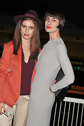 Left to right, TALI LENNOX and ERIN O'CONNOR at a dinner hosted by Calvin Klein Collection to celebrate the future Home of The Design Museum at The Commonwealth Institute, Kensington, London on 13th October 2011.