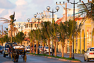 All kinds of transportation make their way down the streets of Cozumel, Mexico on a warm winter evening.