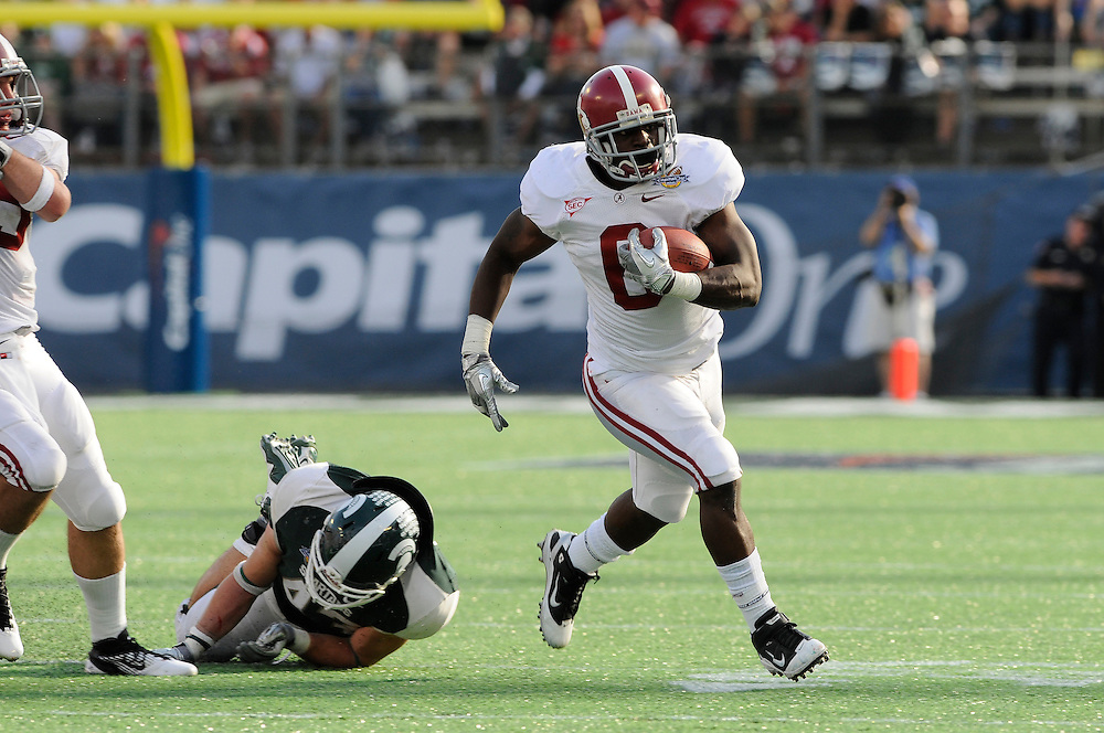 January 1, 2011: Demetrius Goode of the Alabama Crimson Tide avoids the attempted tackle from Eric Gordon of the Michigan State Spartans during the NCAA football game between Michigan State Spartans and the Alabama Crimson Tide at the 2011 Capital One Bowl in Orlando, Florida. Alabama defeated Michigan State 49-7.