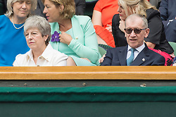 © Licensed to London News Pictures. 13/07/2019. London, UK.  British Prime Minster Theresa May and husband Phillip May watch the ladies singles finals on centre court tennis on Day 12 of the Wimbledon Tennis Championships 2019 held at the All England Lawn Tennis and Croquet Club. Photo credit: Ray Tang/LNP