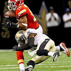 September 23, 2012; New Orleans, LA, USA; New Orleans Saints safety Roman Harper (41) breaks up a pass to Kansas City Chiefs wide receiver Steve Breaston (15) during the overtime of a game at the Mercedes-Benz Superdome. The Chiefs defeated the Saints 27-24 in overtime. Mandatory Credit: Derick E. Hingle-US PRESSWIRE