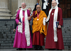 © Licensed to London News Pictures. 14/05/2012. City of London, UK The Right Reverend Michael Colclough,The Dalai Lama (C with medal) and The Bishop of London Richard Chartres leaves St Paul's Cathedral today 14 may 2012 after being presented with the £1.1m Templeton annual prize in his first visit to the Cathedral. The award is for a living person who has 'made an exceptional contribution to affirming the spiritual dimension of life'.. Photo credit : Stephen Simpson/LNP