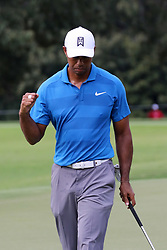 September 22, 2018 - Atlanta, GA, U.S. - ATLANTA, GA - SEPTEMBER 22:    Tiger Woods reacts to a birdie putt on the 4th hole during the third round of the Tour Championship on September 22, 2018, at East  Lake Golf Club in Atlanta, GA.  (Photo by Michael Wade/Icon Sportswire) (Credit Image: © Michael Wade/Icon SMI via ZUMA Press)