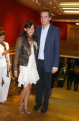 FRITZ VON WESTENHOLTZ and CAROLINE SIEBER at '4 Inches' a project 'For Women about Women By Women' - A photographic Auction in aid of the Elton John Aids Foundation hosted by Tamara Mellon President of Jimmy Choo and Arnaud Bamberger MD of Cartier UK at Christie's, 8 King Street, London W1 on 25th May 2005.<br />