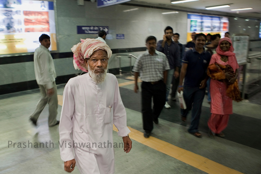 Raheez Ahmad, 67 walks inside the Central Secratariat station as he changes his route from one line to another of the Delhi Metro network in New Delhi, India, on Friday, October 22, 2010. Photographer: Prashanth Vishwanathan/HELSINGIN SANOMAT