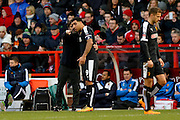 Watford Manager Quique Flores and Watford forward Troy Deeney  have a discussion during the The FA Cup fourth round match between Nottingham Forest and Watford at the City Ground, Nottingham, England on 30 January 2016. Photo by Simon Davies.