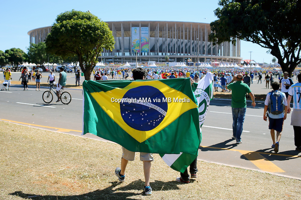 Fans of Brazil make their way to The National Stadium / Estadio Nacional Mane Garrincha in Brasilia, Brazil, host venue of the FIFA 2014 World Cup