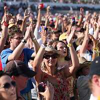 Fans react to Pat Monahan of the Grammy award winning band Train  during a one hour performance prior to the start of the NASCAR Coke Zero 400 race at Daytona International Speedway in Daytona Beach, Fl., on Saturday July 7, 2012. (AP Photo/Alex Menendez) Grammy Award winning band TRAIN plays an hour long concert prior to the NASCAR Coke Zero 400 race at Daytona International Speedway in Daytona Beach, Florida on July 7, 2012.
