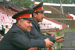 VLADIKAVKAZ, RUSSIA - Monday, September 11, 1995: Two Russian soldiers at the Republican Spartak Stadium home of FC Alania Spartak Vladikavkaz before the UEFA Cup 1st Round 1st Leg match against Liverpool. (Photo by David Rawcliffe/Propaganda)