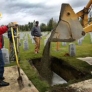 Veteran Shawn Marshall, left, worker ---- and veteran Mark Daigneaultat, right, bury a World War II veteran at Tahoma National Cemetery on Friday November 3, 2006.  Many of the workers at the national cemetery are veterans themselves and perform their jobs with honor and respect.  Joshua Trujillo / Seattle Post-Intelligencer