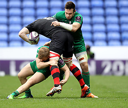 Edinburgh's David Denton is tackled by London Irish's Eoin Griffin and London Irish's Tom Guest - Photo mandatory by-line: Robbie Stephenson/JMP - Mobile: 07966 386802 - 05/04/2015 - SPORT - Rugby - Reading - Madejski Stadium - London Irish v Edinburgh Rugby - European Rugby Challenge Cup