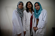 While these medical students at Al Azhar University of Gaza dream of furthering their studies abroad, they want to practice medicine in Gaza once qualified [Tanya Habjouqa]