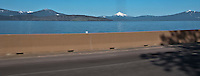 scene along a cross country trip with in a classic Mini Cooper auto - Klamath Lake shore view is blocked by a highway barrier along US 97