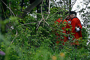 © Licensed to London News Pictures. 21/05/2012. Chelsea, UK. Chelsea Pensioner who fought in Korea take a break in The 'Quiet Time DMZ Forbidden Garden' featuring a Korean lookout tower and a floor of buttons representing those killed in the Korean War.Press preview of The Chelsea Flower Show today 21 May 2012. The world's most famous flower show, which has been held in the grounds of the Royal Chelsea Hospital since 1913, will be open to the public from Tuesday. Visitors are expected to flock in their thousands to see displays of plants, flowers and furniture for ideas on how to decorate their gardens.. Photo credit : Stephen Simpson/LNP