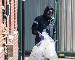 © Licensed to London News Pictures. 06/07/2018. Salisbury, UK. Military and police pecialist teams wearing hazmat suits are seen at John Baker House in Salisbury, Wiltshire an area visited by two people who are in critical condition after being exposed to the Novichok nerve agent. Dawn Sturgess, 44, and Charlie Rowley, 45 have been confirmed as having come in to contact with the deadly agent after samples were sent to the MoD's Porton Down laboratory. Former Russian spy Sergei Skripal and his daughter Yulia were poisoned with Novichok nerve agent in nearby Salisbury in March 2018 causing diplomatic tentions between Russia and the UK. Photo credit: Ben Cawthra/LNP