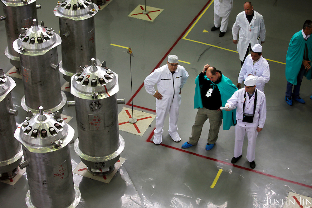 American-Ukrainian physicist Igor Bolshinsky (in green cape) inspects the transfer of highly enriched uranium into casks at the Institute of Nuclear Physics in Almaty, Kazakhstan. .The removal of Kazakhstan's highly enriched uranium (HEU) is part of the U.S. Global Threat Reduction Initiative (GTRI), where Bolshinsky works, that tries to secure nuclear material around the world to prevent their misuse by terrorists and rogue states.