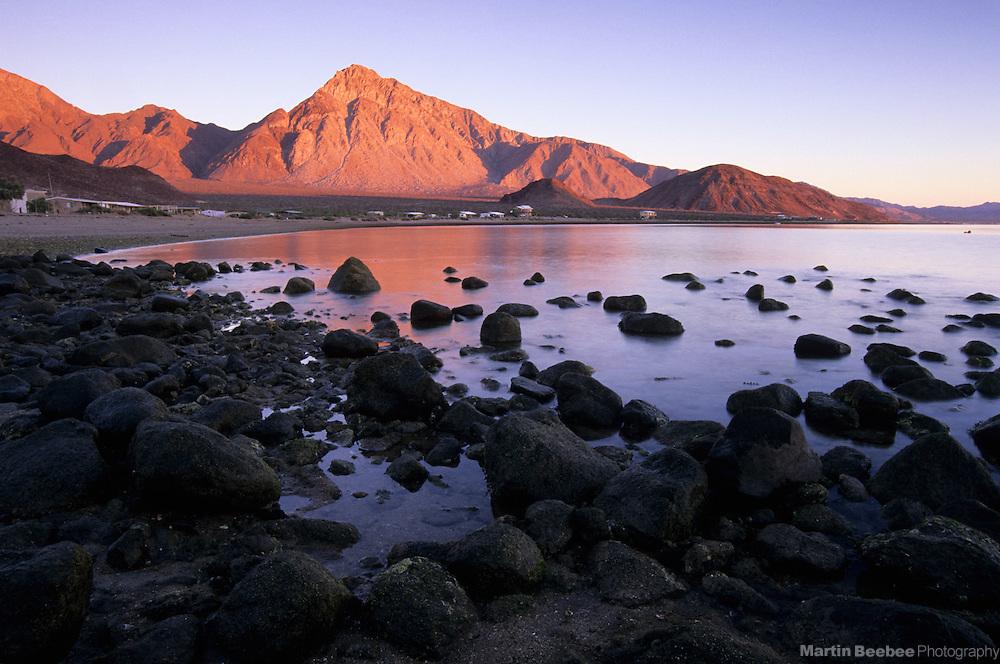 Morning alpenglow on Cerro Santa Ana and desert coastal mountains in Bahia de los Angeles, Baja California, Mexico