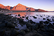 Morning alpenglow on Cerro Santa Ana and desert coastal mountains in Bahia de los Angeles, Baja California, Mexico