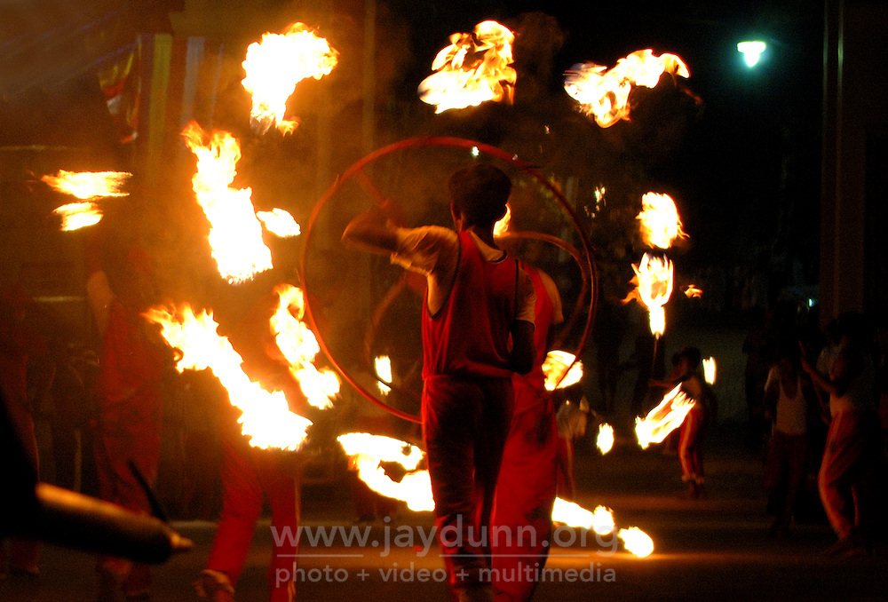 Sri Lanka, Colombo, 2006. The Duruthu Perahera, or procession, a spectacular display of dancers and drummers, flame-throwers, fire-eaters and splendidly caparisoned elephants.