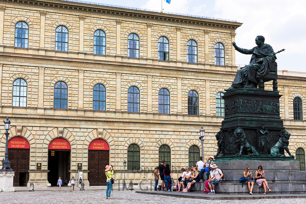 Tourist photographs statue of Maximillian Iosepho, King of Bavaria by the Residenz in Munich, Bavaria, Germany