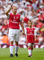 Photo: Daniel Hambury.<br />Arsenal v Ajax. Dennis Bergkamp Testimonial. 22/07/2006.<br />Arsenal's Dennis Bergkamp and son wave goodbye to Arsenal.