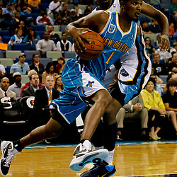 October 9, 2010; New Orleans, LA, USA; New Orleans Hornets small forward Trevor Ariza (1) drives past Memphis Grizzlies small forward Rudy Gay (22) during the first quarter of a preseason game at the New Orleans Arena. Mandatory Credit: Derick E. Hingle