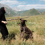'Morchili' Mariami playing with Maxi the dog at the small abbey where she lives in the village of Abano in the Truso Valley, near the border with occupied territory of South Ossetia in the Mtskheta-Mtianeti region of Georgia. The entire valley is all but abandoned, and for most of the year is home only to a lone homesteader, a monk, and four nuns and a priest who live in the abbey.