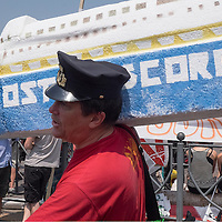 VENICE, ITALY - JUNE 06:  A prtester dressed as Capitan Schettino with a model of the Concordia tmarches towards the Venice Touristic Port on June 6, 2014 in Venice, Italy. Todays protest was to highlight one again the problem of the big cruise ships in Venice and the major works as the MOSE, TAV or Expo 2015.  (Photo by Marco Secchi/Getty Images)