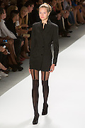 Black chalkstripe mini-dress with a print back. By Zang Toi, shown at his Spring 20132 Fashion Week show in New York.