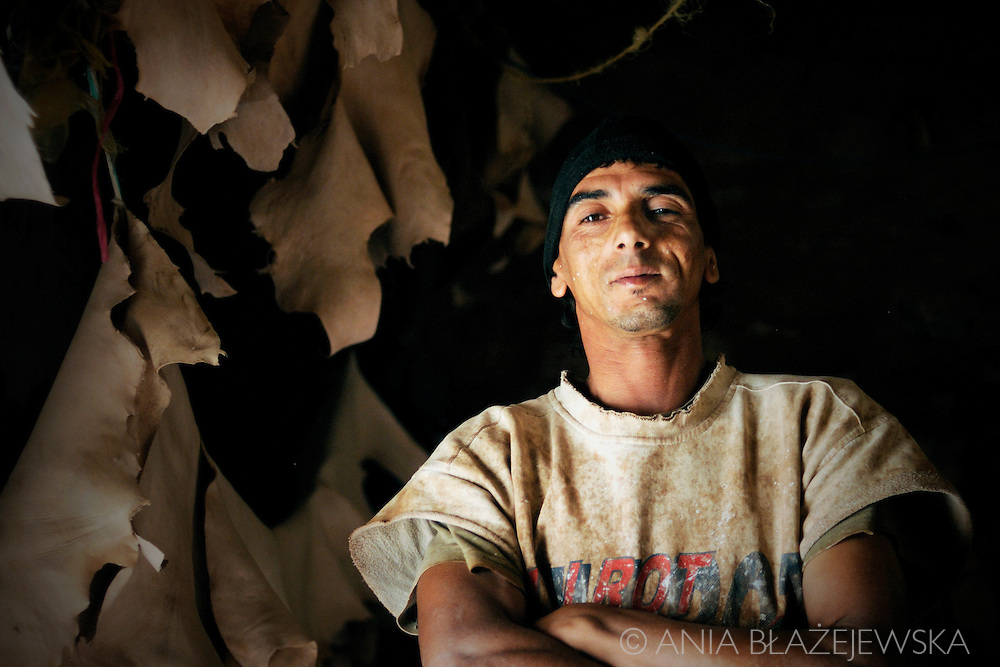 Morocco, Marrakesh. Portrait of a proud tanner working in the tannery in Marrakesh.