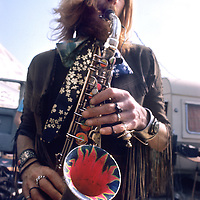 Nik Turner with his colourful saxaphone.- A magnificent seven foot banner of this image of Nik was hung for our 2011 exhibition at Swansea Museum to mark the occasion of the official opening by Nik. Nik Remnisced of the 1970 festival and busked on his sax - much to the delight and entertainment of the guests..A colleague from the original Hawkwind, Thomas Crimble, kindly loaned the guitar he played at the festival in 1970 as an exhibit for the exhibition. Both Nik and Thomas currently play in Space Rictual.