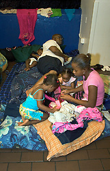 30 August, 2005. New Orleans Louisiana. Hurricane Katrina aftermath. <br /> A family camps in appalling conditions as thousands of people seek shelter inside the New Orleans Saints' Superdome. Approximately 20,000 storm evacuees are housed at the Superdome.<br /> Photo Credit: Charlie Varley/varleypix.com