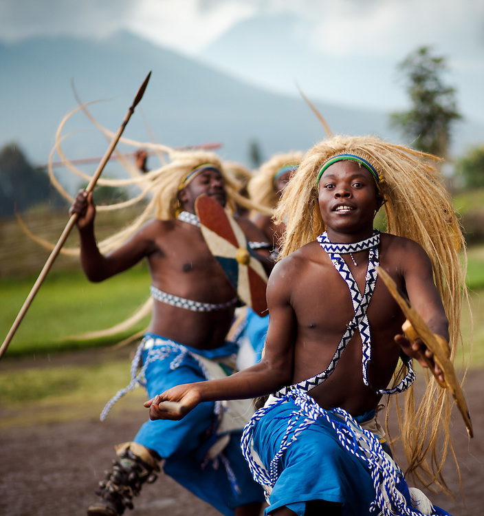 Traditonal tribesman and musicians form part of a greating at Iby'Iwacu cultural village