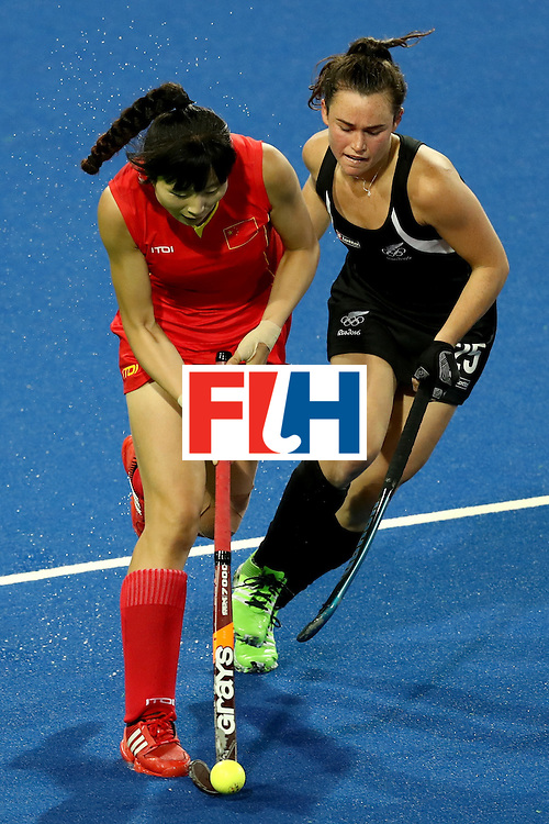 RIO DE JANEIRO, BRAZIL - AUGUST 13: Qingling Song of China and Kelsey Smith of New Zealqnd compete for the ball  in the Women's Pool A match between the People's Republic of China and New Zealand on Day 8 of the Rio 2016 Olympic Games at the Olympic Hockey Centre on August 13, 2016 in Rio de Janeiro, Brazil.  (Photo by Phil Walter/Getty Images)
