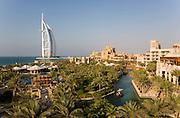 Madinat Jumeirah Resort. Al Qasr Hotel. Burj Al Arab (l.), electric abras (water texis).
