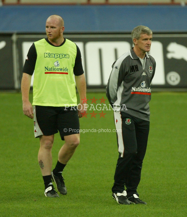 MILAN, ITALY - Thursday, September 4, 2003: Wales' Mark Hughes and John Hartson during training at the San Siro ahead of their Group 9 Euro 2004 qualifyer against Italy. (Pic by David Rawcliffe/Propaganda)