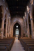 Arches, Columns, Pews and Aisle leading to Stained Glass Window, Sheffield Cathedral Interior, West End, UK