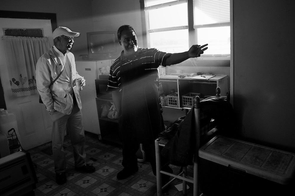"""Ernest Parks and Anthony Lafayette hang out in the kitchen of Jackie's Spot, a juke joint located on Mosquito Beach in the Sol Legare community on James Island. The """"beach"""" is a quarter-mile strip of marshland and mud, but back when segregation was still in effect, it was one of the few waterfront areas that welcomed African Americans. There was not much swimming to be had but they danced, drank and ate in the restaurants and juke joints."""