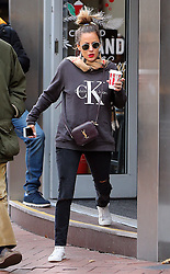 Caroline Flack wearing a Burberry scarf, Calvin Klein Jeans sweatshirt, ripped jeans and Nike trainers out and about in London. The 37-year-old TV presenter looked lines free and alson supporting a new star tattoo on her ear...  17/11/2016<br />