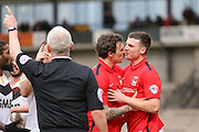 Coventry City forward Darius Henderson  calms down Coventry City defender Chris Stokes  after an altercation during the Sky Bet League 1 match between Port Vale and Coventry City at Vale Park, Burslem, England on 7 February 2016. Photo by Simon Davies.