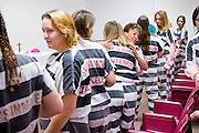 25 DECEMBER 2004 - Bishop Thomas Olmsted, Bishop of the Phoenix Diocese of the Catholic Church, leads Christmas Day services for women in the Maricopa County Jail in Phoenix, AZ, Dec. 25. Bishop Olmsted leads Christmas services at the jail every year. This year 18 women attended the mass. In 2011, the US Department of Justice issued a report highly critical of the Maricopa County Sheriff's Department and the jails. The DOJ said the Sheriff's Dept. engages in widespread discrimination against Latinos during traffic stops and immigration enforcement, violates the rights of Spanish speaking prisoners in the jails and retaliates against the Sheriff's political opponents.   PHOTO BY JACK KURTZ