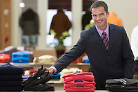 Businessman in Clothing Store