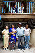 San Miguel de Allende, Guanajuato, Mexico, 8/29/08: Antonio Nolasco and his family, l-r, upstairs: Veronica,  Gloria, Maria del Carmen, downstairs: daughter-in-law Brenda Yanez, wife Consuela Ramirez Nolasco, with grandson David, Antonio, in the home which was built by Casita Linda. It is a Mexican non-profit organization, started and run by North Americans, which builds adobe homes for families in extreme poverty (photo: Ann Summa).