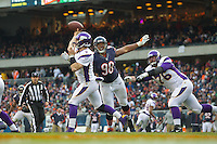 25 November 2012: Quarterback (7) Christian Ponder of the Minnesota Vikings passes the ball with (98) Cory Wootton of the Chicago Bears in his face during the second half of the Bears 28-10 victory over the Vikings in an NFL football game at Soldier Field in Chicago, IL.