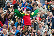 A parrot fan during day 3 of the first Investec Test Series 2016 match between England and Sri Lanka at Headingly Stadium, Leeds, United Kingdom on 21 May 2016. Photo by Simon Davies.