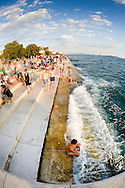 Evening on the waterfront by the Sea Organ in Zadar, Croatia