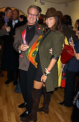 Artist JEFFREY KROLL and stylist MISS CHARLOTTE STOCKDALE at an exhibition of art by Jeffrey Kroll entitled Imirage held at the Arndean Gallery, Cork Street, London on 19th October 2005.<br />
